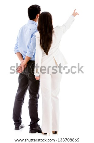 Business people pointing away - isolated over a white background