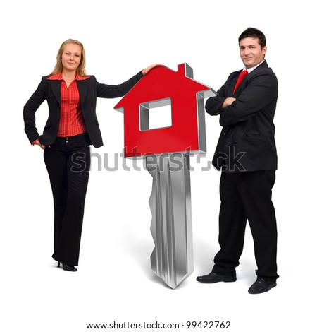 Business people presenting a 3d rendered red home key - stock photo