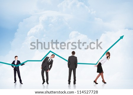 business people pushing a business graph upwards