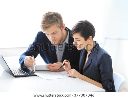 Business people reading contract in the office - stock photo