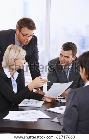 Business people reviewing contract at meeting in office.? - stock photo
