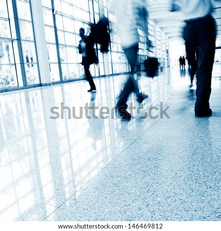 Business people rushing in the lobby. motion blur - stock photo