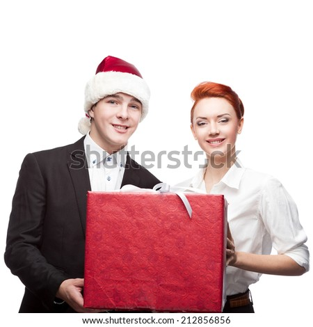 business people santa hat holding big red present isolated on white - stock photo