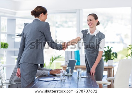 Business people shake hands during interview in office - stock photo