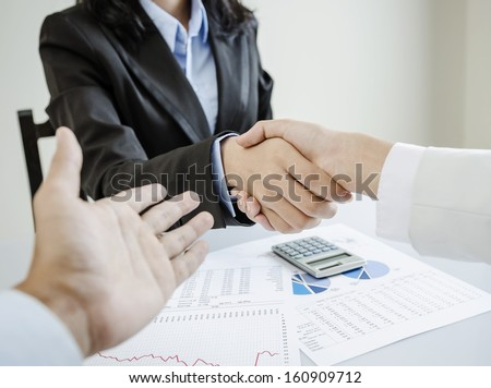 Business people shake hands for the first meet - stock photo