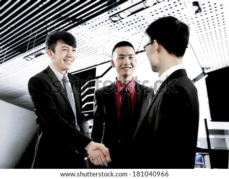 business people shake hands in the office - stock photo
