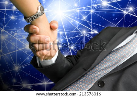 business people shaking hand on global business background - stock photo