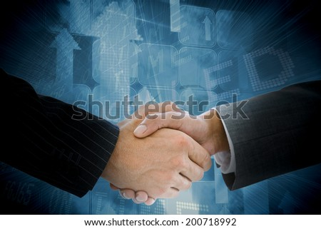 Business people shaking hands against airport departures board - stock photo