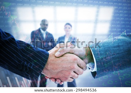 Business people shaking hands against stocks and shares - stock photo