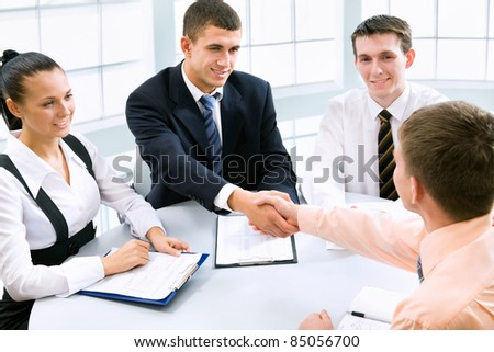 Business people shaking hands at a meeting - stock photo