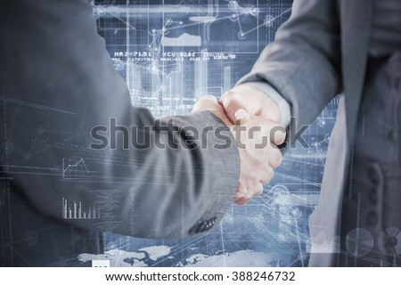 Business people shaking hands close up against hologram background