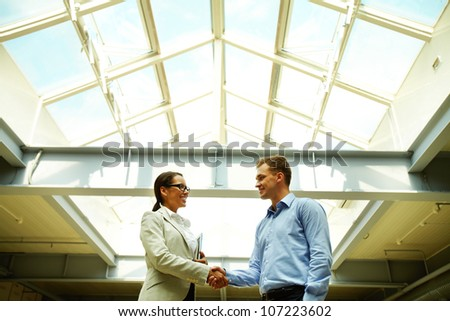 Business people shaking hands concluding a deal or greeting each other - stock photo