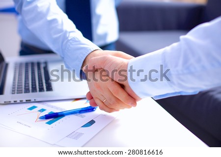 Business people shaking hands, finishing up a meeting - stock photo