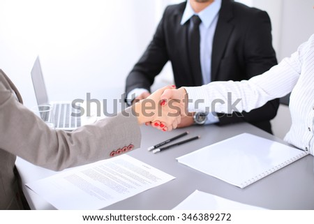 Business people shaking hands, finishing up a meeting. Copy space  at the left corner