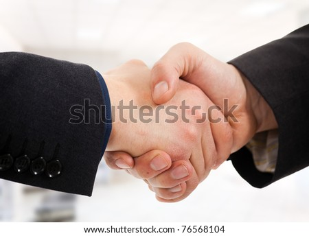 Business people shaking hands. Office environment - stock photo
