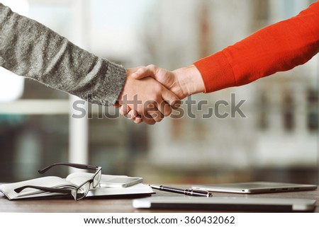 Business people shaking hands, on office background - stock photo