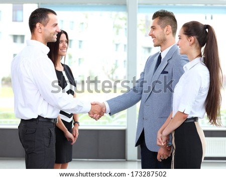 Business people shaking hands over a deal  - stock photo