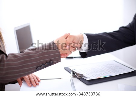 Business people shaking hands, standing - stock photo