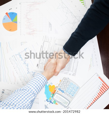Business people shaking hands - view from top - 1 to 1 ratio - stock photo
