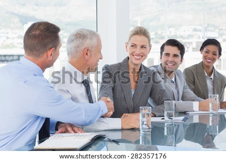Business people shaking their hands in the office - stock photo