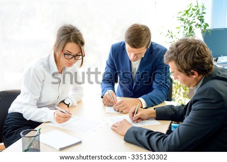 Business People Signing the Contract around the Table in Bright Modern Office. Business Cooperation Concept - stock photo