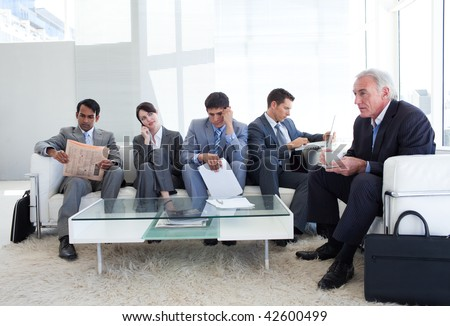 Business people sitting and waiting for a job interview. Business concept.