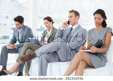 Business people sitting and waiting in the office
