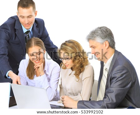 Business people sitting at a corporate meeting working in laptop