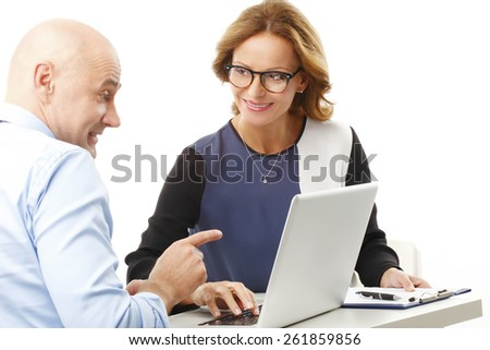 Business people sitting at desk in front of laptop and discussing problems. Isolated on white background.  - stock photo