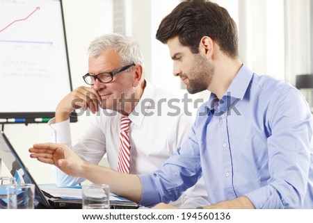 Business people sitting at meeting and  working on laptop. - stock photo