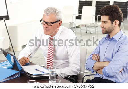 Business people sitting at meeting and  working on laptop. Teamwork at office. - stock photo