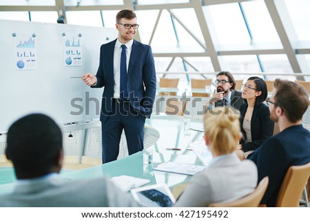 Business people sitting at presentation in office