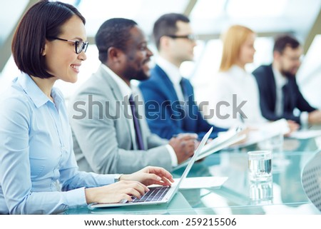 Business people sitting attentively at meeting - stock photo