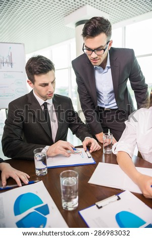 Business people sitting in meeting room at office and working. - stock photo