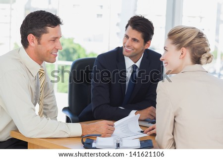 Business people smiling during a meeting in the office - stock photo