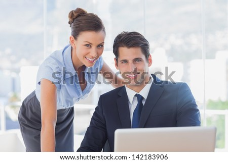 Business people smiling together in the office - stock photo