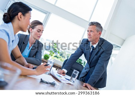 Business people speaking together during meeting in office - stock photo