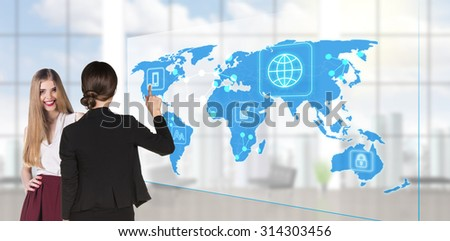 business people standing in modern office and looking to global business map. Elements of this image furnished by NASA - stock photo