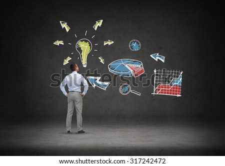 business, people, startup and strategy concept - businessman looking at business idea scheme over concrete room background from back - stock photo