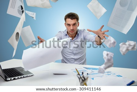 business, people, stress, emotions and fail concept - angry businessman throwing papers in office over blue background - stock photo