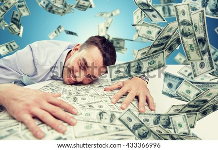 business, people, success and fortune concept - happy businessman with heap of dollar money over blue background - stock photo