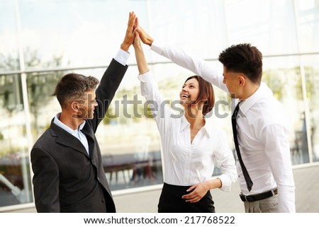 Business People. Successful Team Celebrating a Deal - stock photo