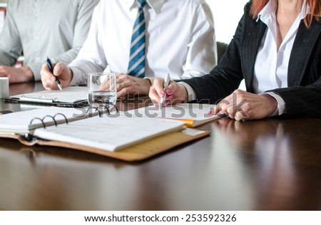 Business people taking notes during a training