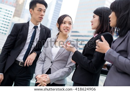 Business people talk to each other - stock photo