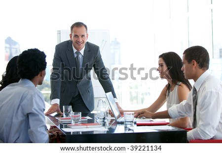 Business people talking about a new business plan in office