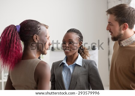 Business people talking at office. Multiracial group of people