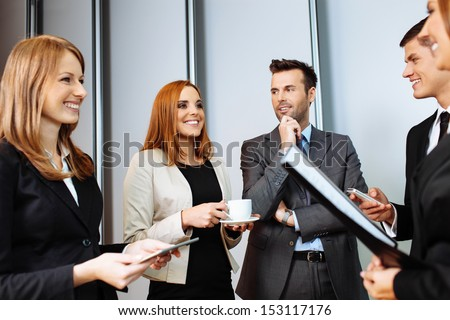 Business people talking during conference break; networking - stock photo