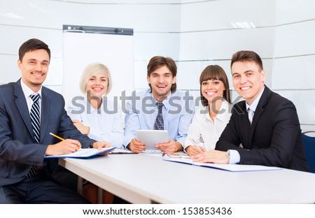 business people team smile sitting at desk in office meeting conference room, businesspeople group working with colleague - stock photo