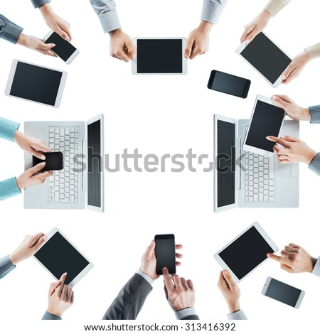 Business people team social networking and using computers, tablets and smartphones, top view, white background, blank copy space at center - stock photo