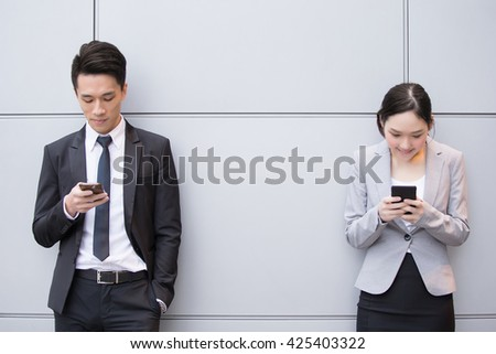 Business people team use smart phone in the office, shot in Hong Kong, asian woman and man - stock photo